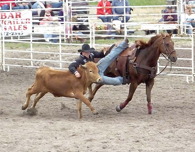 rock Henry competed in the steer wrestling in Stapleton, Neb.