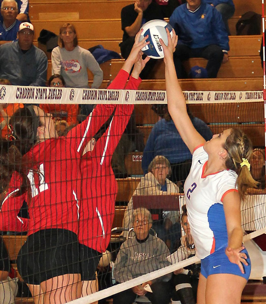 Carlee Hinn jousts with Ashlea Kerr and another Chadron defender in Monday night's subdistrict action.