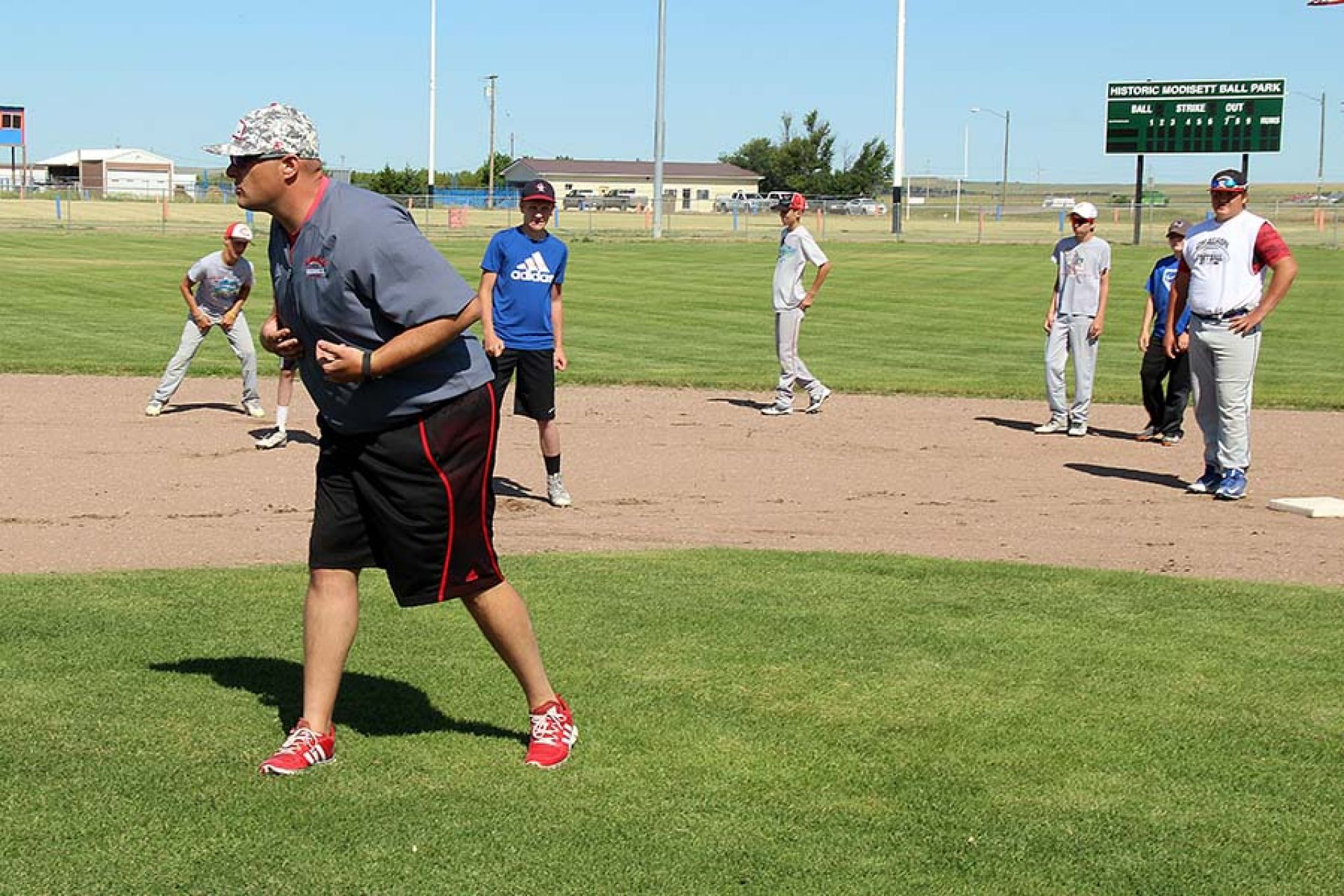 Ledbetter acts as pitcher during a second base footwork drill.