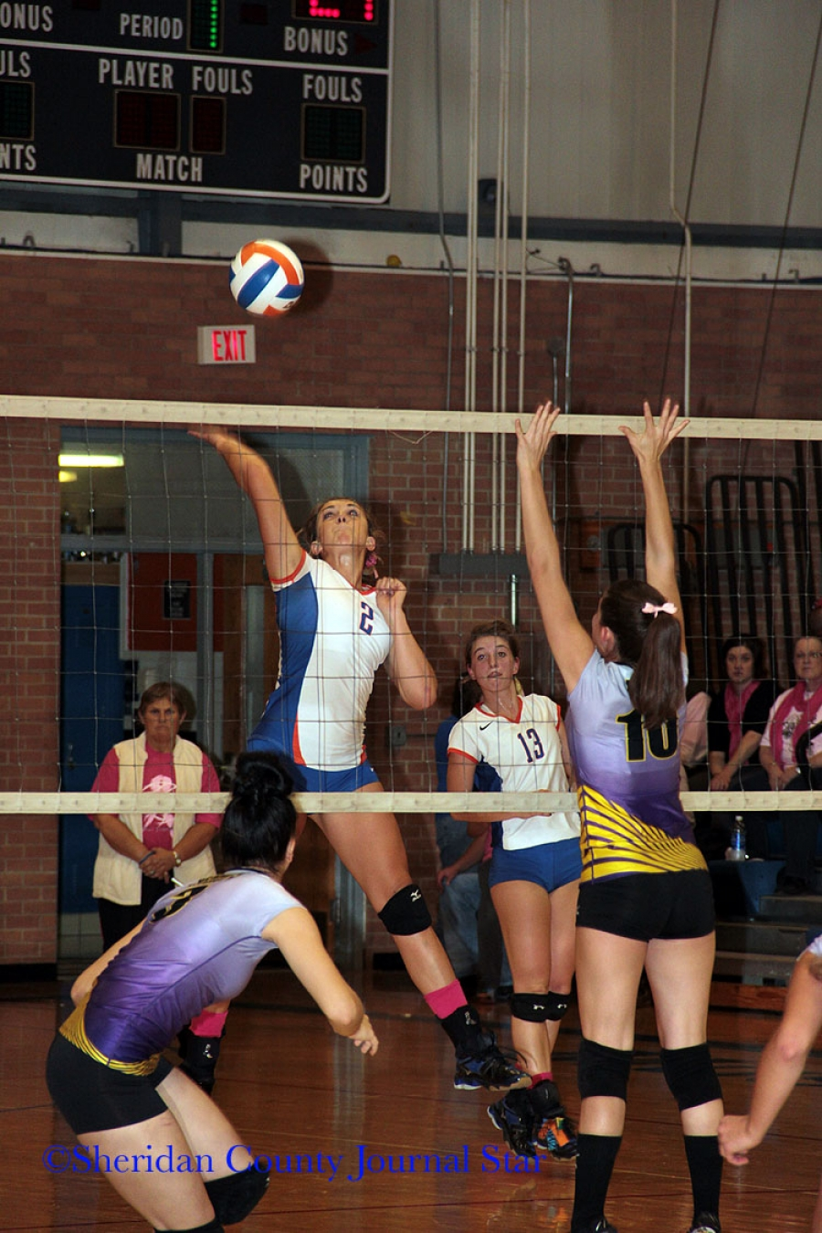 Carlee Hinn goes up for a spike in JV action against the Lady Warriors.