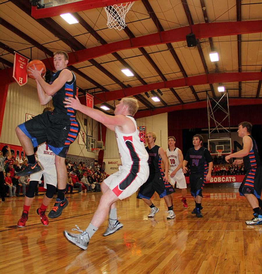 Kyle Anderson rips down a rebound in basketball action vs Hemingford on Friday.