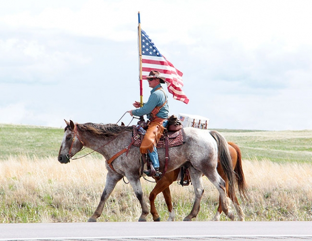 Sam Hubbard travels east toward Gordon on his six-year-old quarter horse, Ruger. Hubbard is performing a One Nation Ride, riding across the United States of America spreading patriotism  and unity.
