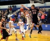 Gordon-Rushville's Ryan Schwarting takes a contested shot against Chadron Thursday in the subdistrict C1-12 final.