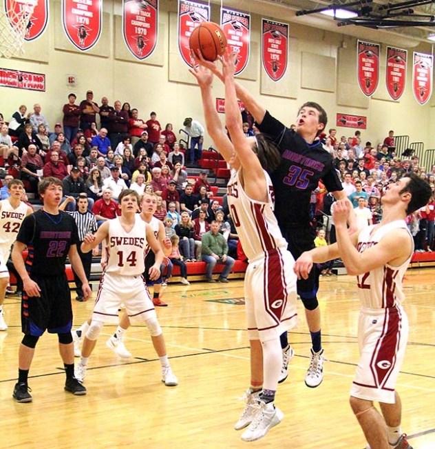 Gordon-Rushville's Sean Combs pulls a rebound away from a Gothenburg Swede Monday night in the District Finals in Sidney.