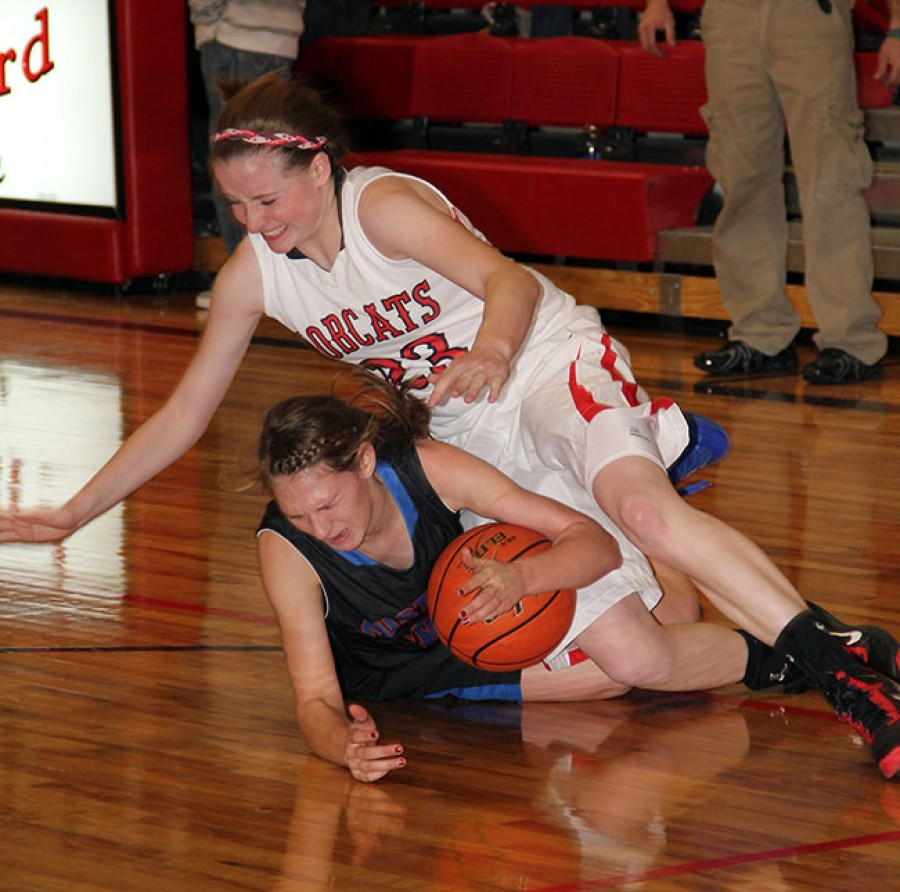In a game that sometimes looked like a wrestling match, Ashton Sasse battles for a loose ball on Friday in Hemingford.