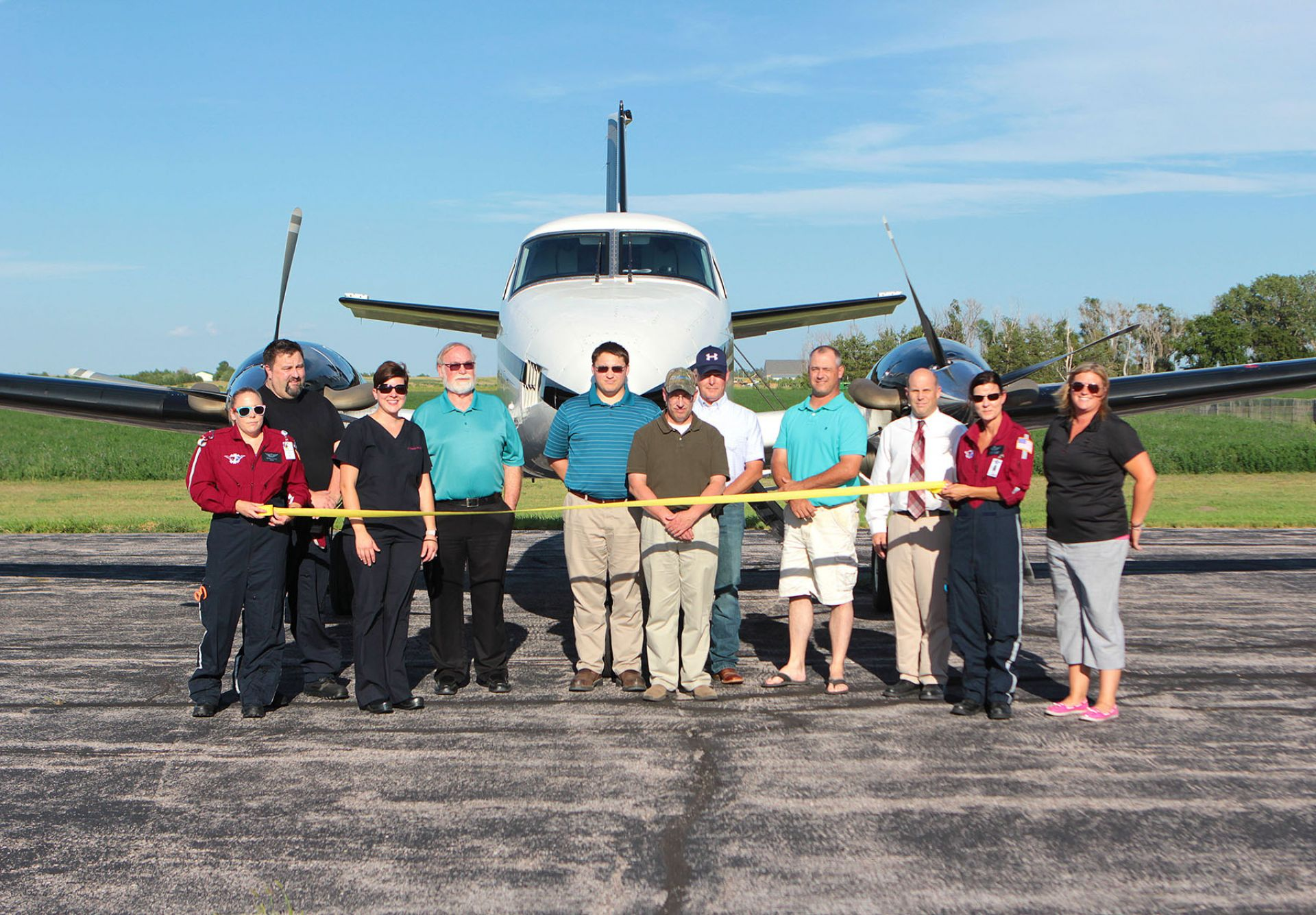 Pictured, L-R: Michelle Rood, EagleMed RN Flight Nurse; Ryan Allen, EagleMed Pilot; Cassie Banks NP-C, DNP; GMHS CEO William Giles; Gordon City Manager Jacob Sheridan; Glenn Spaugh; Mark Kruger; Eric Halverson; Dr. Christopher Costa, MD; Wendy Blackos, RN, Flight Nurse; and Holly Anderson, Area 3 Director.