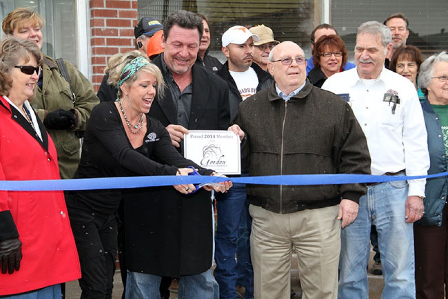 Open Range Beef owners Jill Noetzelman and Pat Shudak cut the ribbon during their grand opening on Tuesday. Pictured from left are: Gordon Mayor Nancy Russell, Jill Noetzelman, Pat Shudak, Gordon City Manager Fred Hlava, and ORB Plant Manager, David Blake.