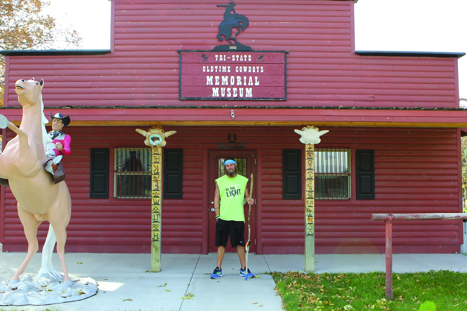 George Ross stands in front of the Tri-State Cowboy Museum in Gordon, where he has stopped for a few days on his cross-country walk from New York to the west coast.