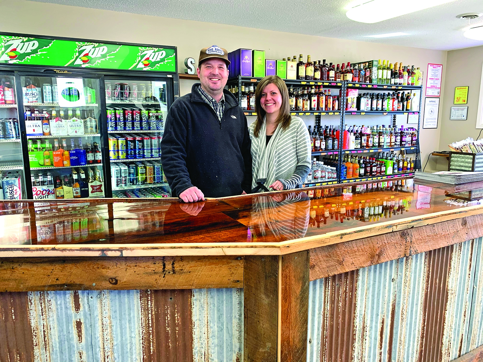 Jordan and Amanda Strain stand behind the counter of their new business, Sidetracks, in Gordon.