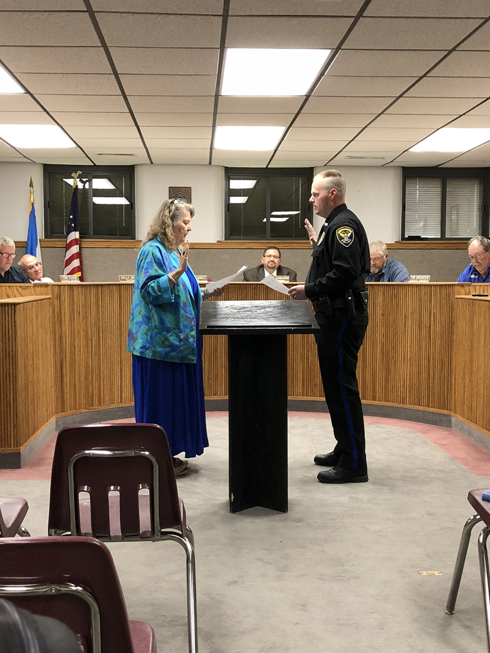 Mayor Nancy Russell swears in Officer Benjamin Plemons at the Gordon City Council meeting on August 6.