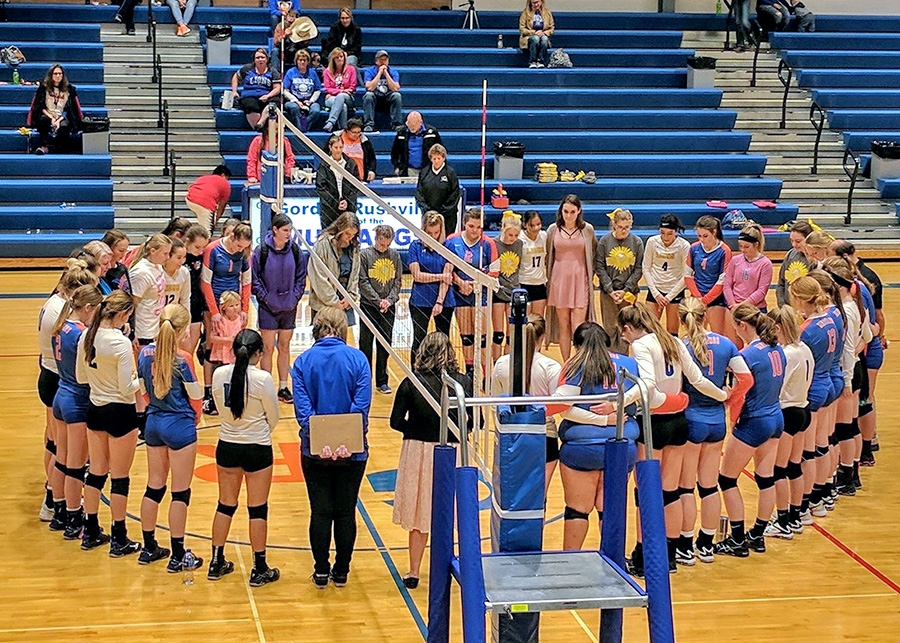 Lady Mustangs, Lady Lions come together after volleyball match to remember Lily Martin