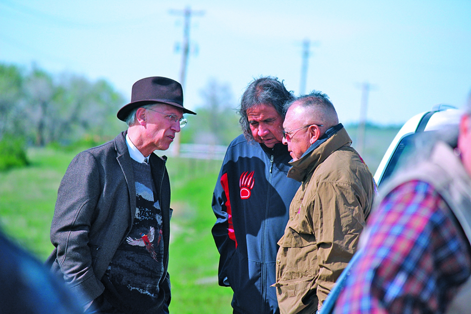Photo by Lauren Brant – Attorney David Domina speaks with activists Frank LaMere and Sonny Skyhawk before the rally on Sunday.