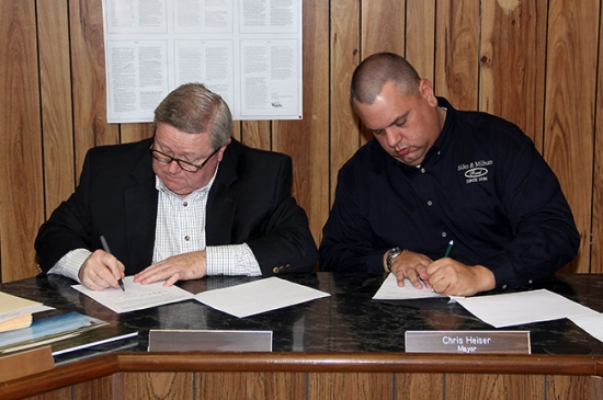 John Gottschalk and Chris Heiser sign copies of the memorandum of understanding, which lays out the responsibilities of the City of Rushville and the Carmen and John Gottschalk Foundation with regards to the Modisett Ball Park project. The documents were signed at a special meeting in Rushville last Wednesday morning.