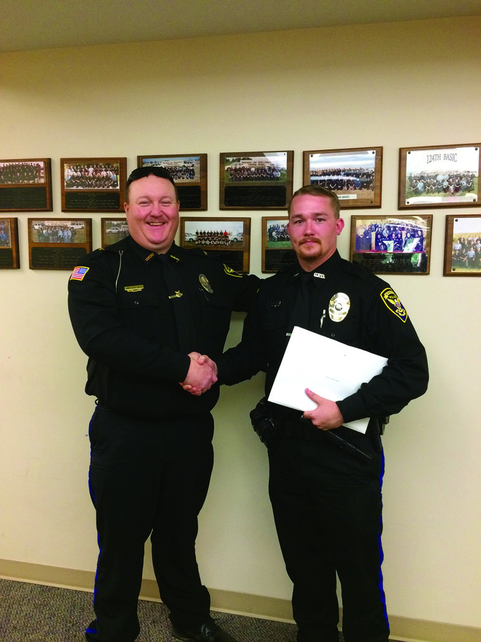 Gordon Police Department's newest Police Academy graduate, Officer Colin Hyatt, shakes hands with Chief of Police, Clay Heath after graduation.