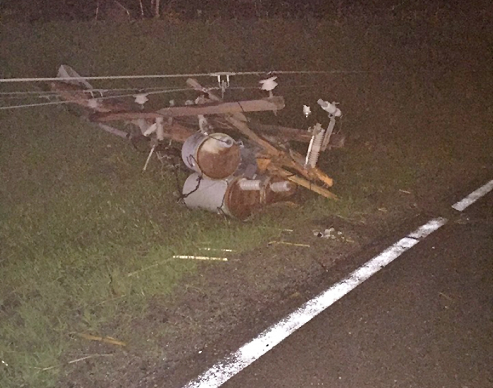 A power pole lays on the ground 5 mi. south of Rushville after Sunday's storm.