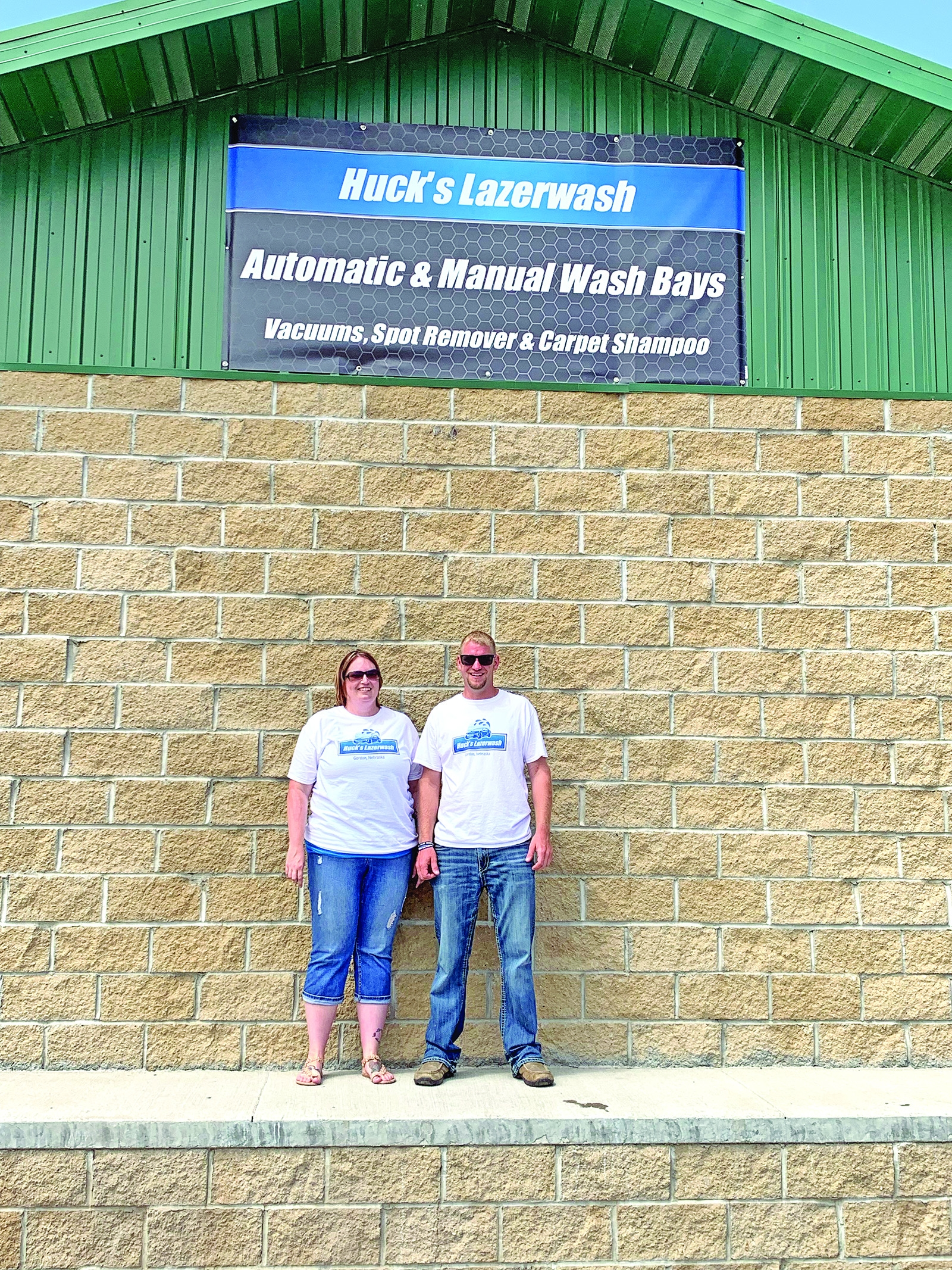 Aaron and Shannon stand in front of Huck's Lazerwash during a special meet and greet event July 27.