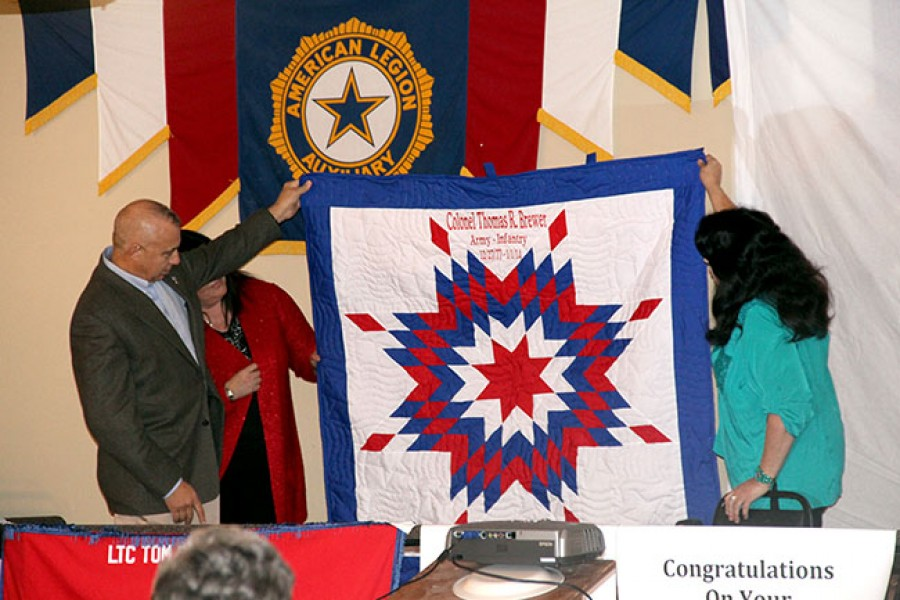 Colonel Thomas R. Brewer was presented with a quilt by family members in honor of his retirement at the Gordon Legion Friday night.