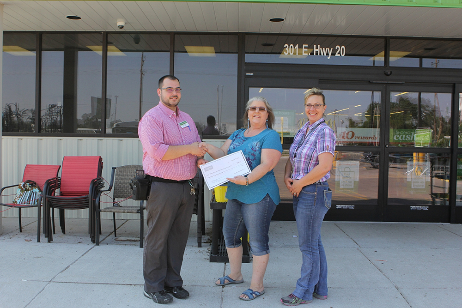 Shopko Manager Gordon Thiessen, left, and Althea Mitchell-Thayer, right, present Juli Ann Harvey, center, with a check for $500 from the Shopko Foundation on Friday, August 10.